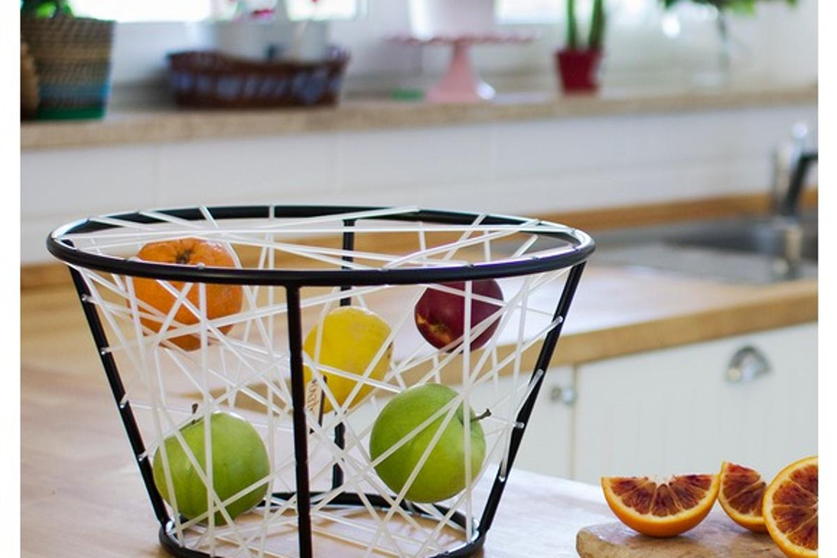 The Wassily fruit bowl features silicone elastic webbing designed to prolong the life of fruit