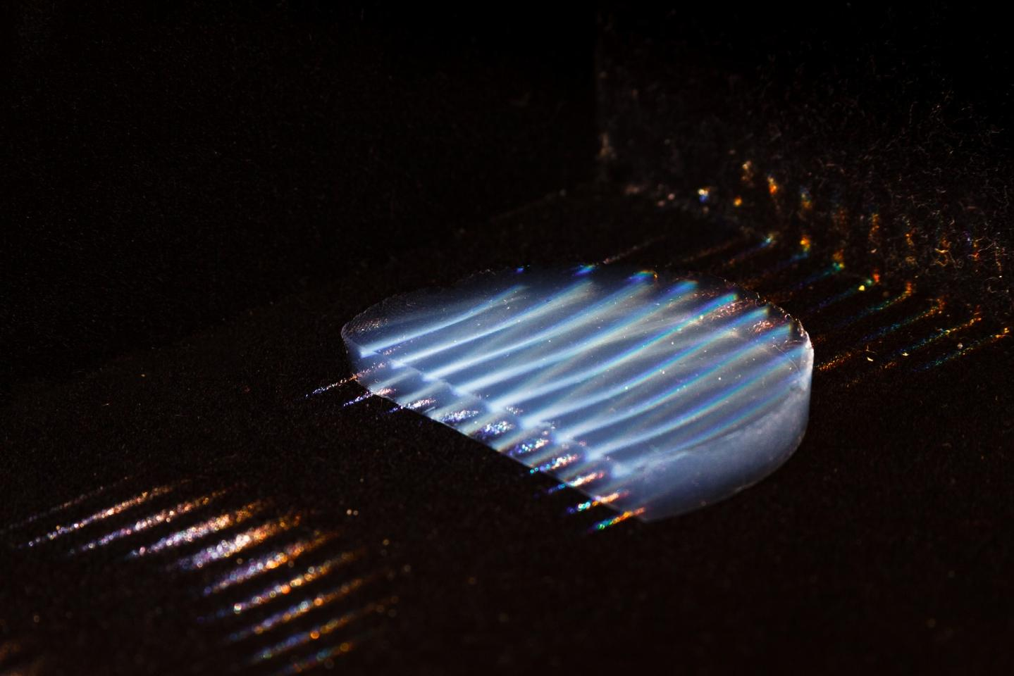 A sample of the aerogel, with parallel laser beams running through it to make it visible for the photo