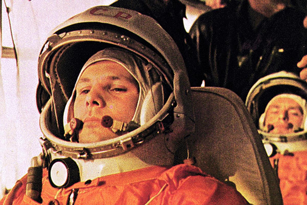 Yuri Gagarin with backup cosmonaut with Gherman Titov sitting behind him