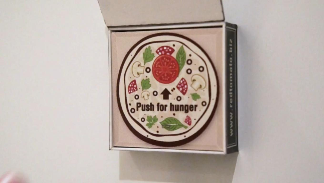 A Dubai-based pizza shop is offering refrigerator magnets to customers that automatically orders their favorite pizza over the Internet when the button on it is pressed