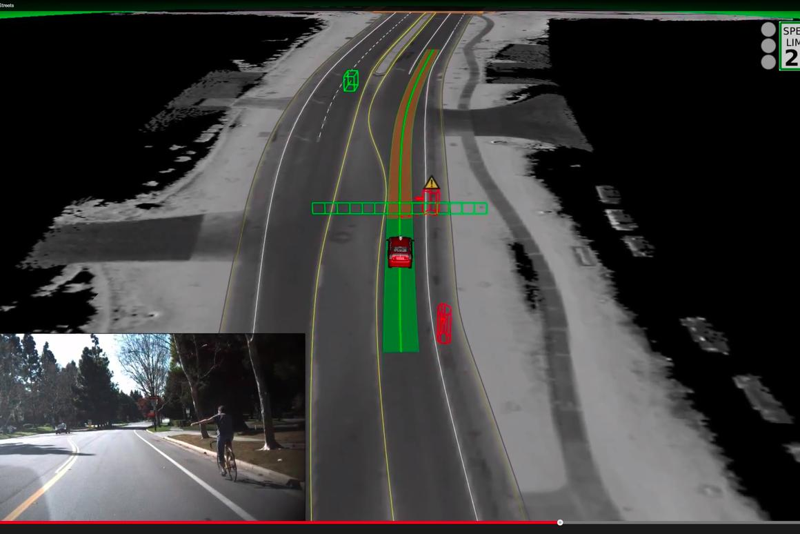 Google's self driving car waits for a cyclist who is making a hand signal