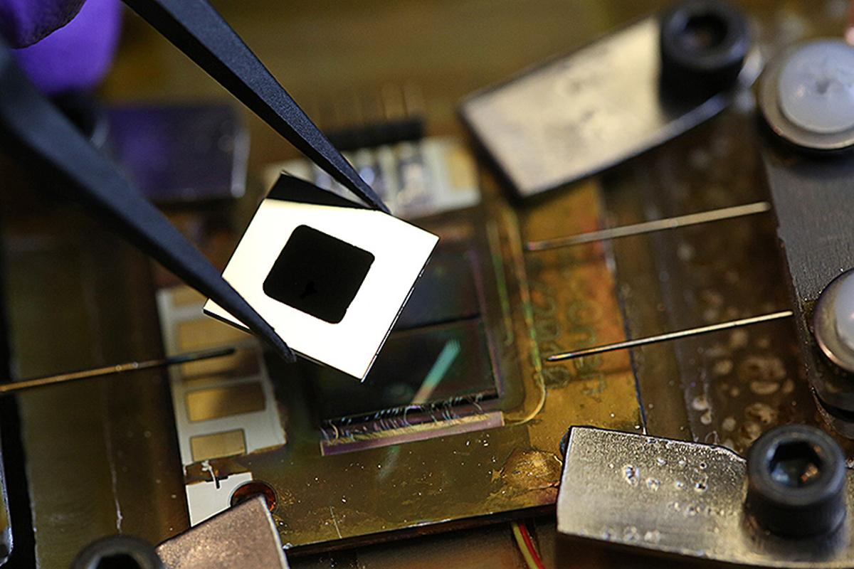 A closeup of the tiny thermal PV system, in which a carbon nanotube layer absorbs solar energy and heats the single layer of photonic crystals, which re-emits energy back at a optimal wavelength for the solar cell