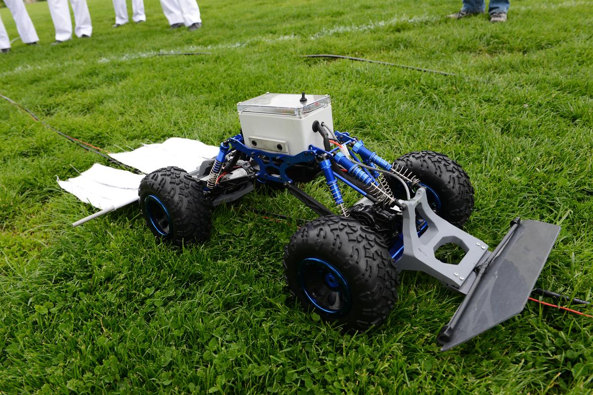 The tick rover drags an insecticide-laced cloth behind it (Photo: VMI Photos by John Robertson IV)