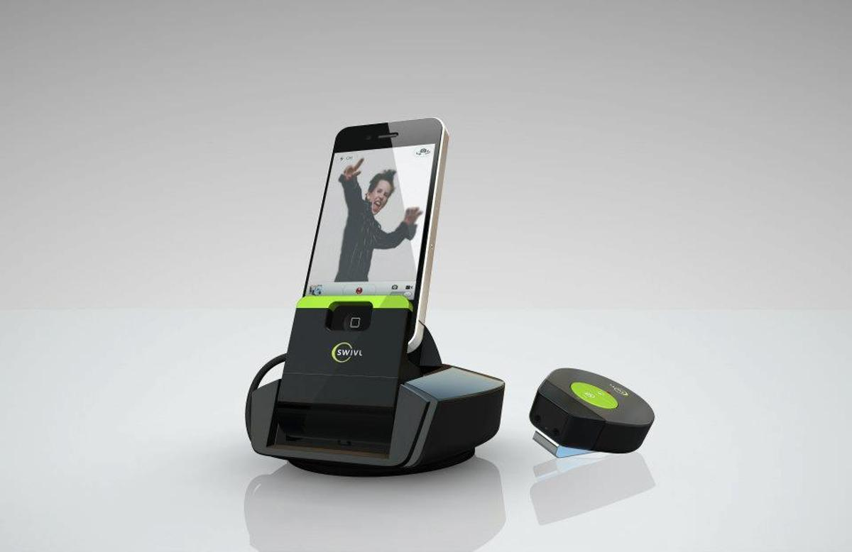 The Swivl is a camera phone mount that automatically pans and tilts to keep the subject framed within the phone's shot