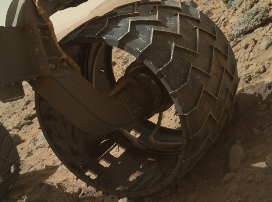 Signs of wear begin to show on Curiosity's left-front wheel (Photo: NASA)