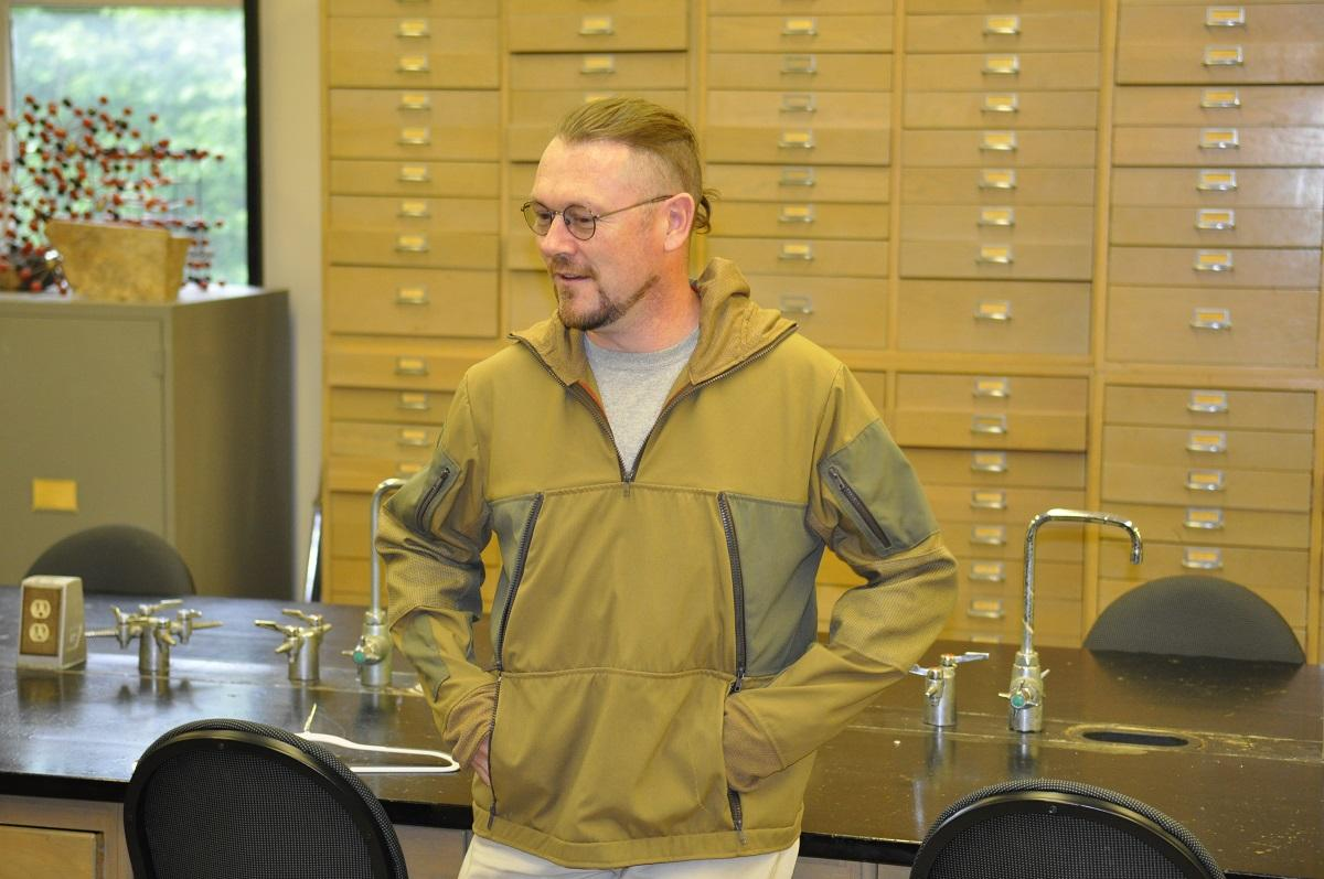 Alan Whittington, chair of the Department of Geological Sciences at the MU College of Arts and Science, tries on the jacket of the lava suits created by Abby Romine