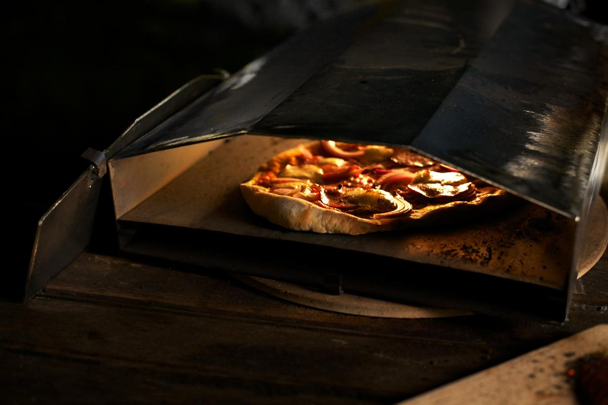 The Uuni is a lightweight, wood-burning pizza oven that's small enough to fit in a kitchen and cooks a pizza in under three minutes