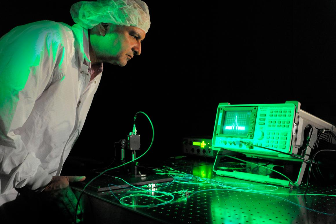 Goddard physicist Babak Saif with the broadband laser system (Photo: NASA/Pat Izzo)