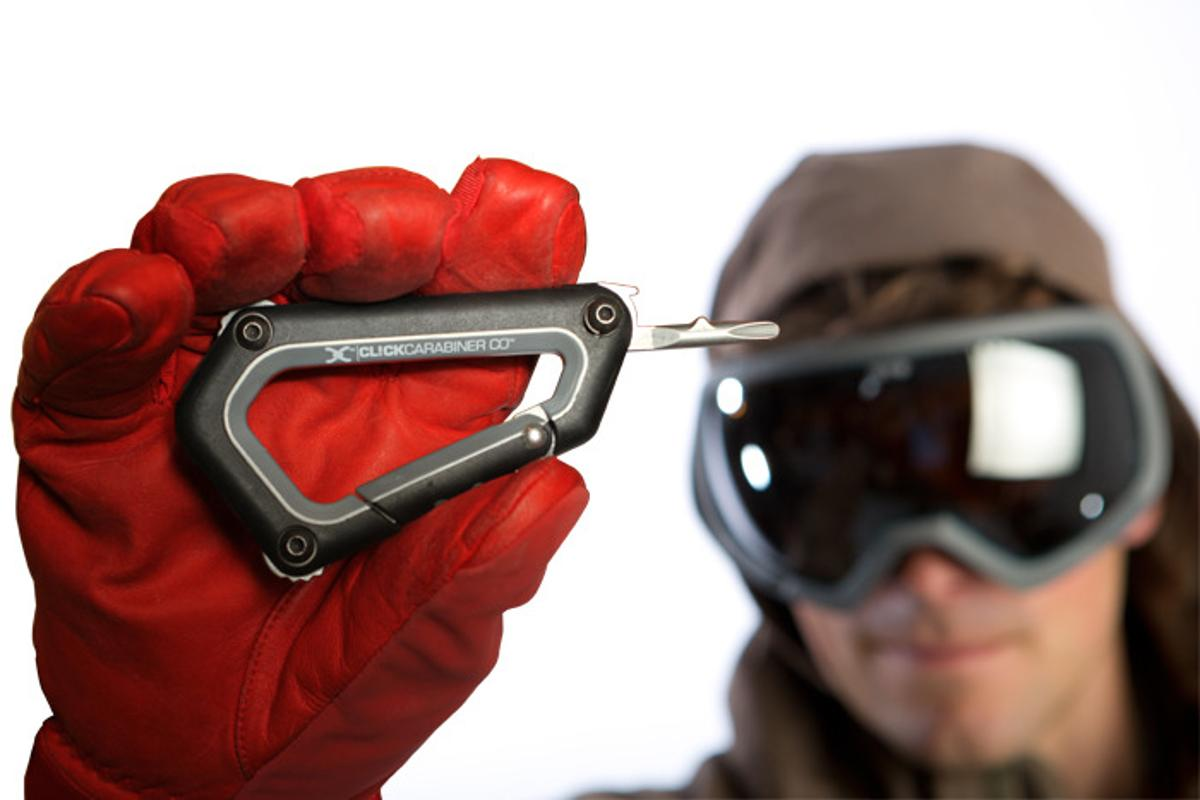 The CL!CK Carabiner is a tool designed to let skiers and riders make repairs on the hill