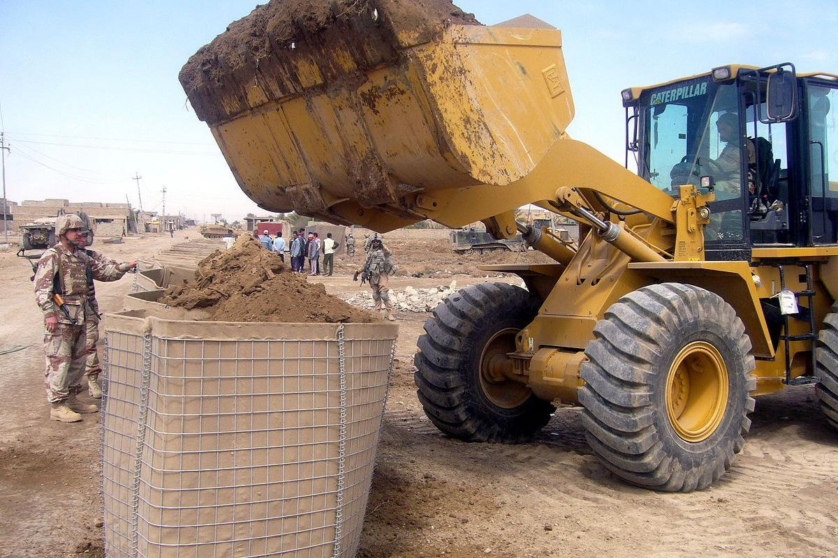 A Hesco Bastion being filled by a front loader in Iraq