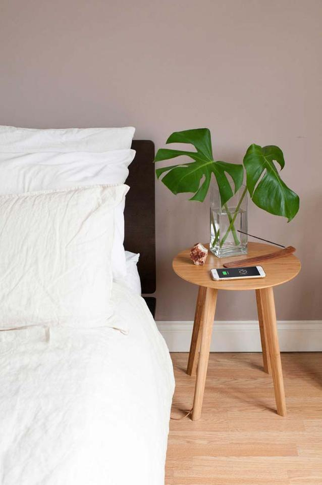 The FurniQi side table combines wireless Qi technology with bamboo wood construction