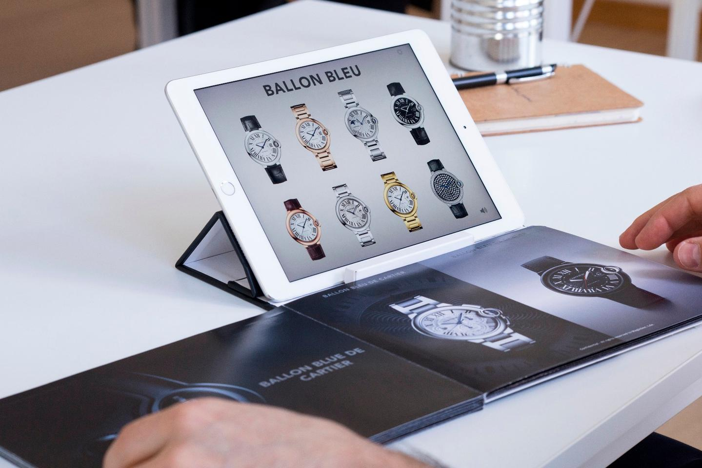 Turning to a page on wristwatches in the physical Magik Book brochure could bring up all available options for a brand on the tablet screen