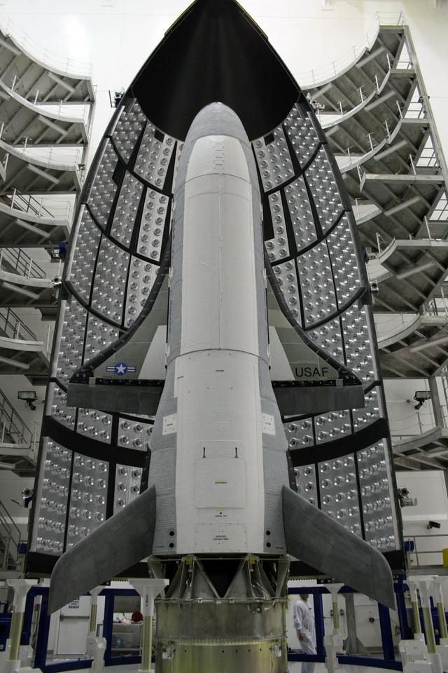 X-37B being installed in its rocket fairing prior to launch (Image: US Air Force)
