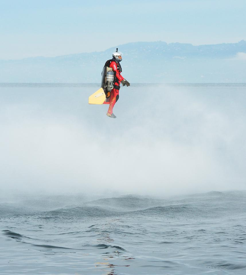 Jetman Yves Rossy in a stable VTOL hover