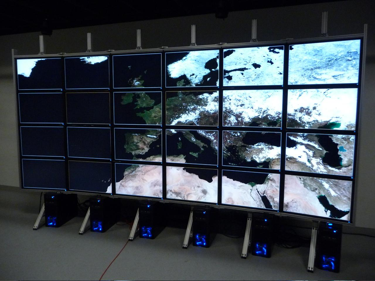 Gigapixel preview of a satellite image displayed across multiple monitors