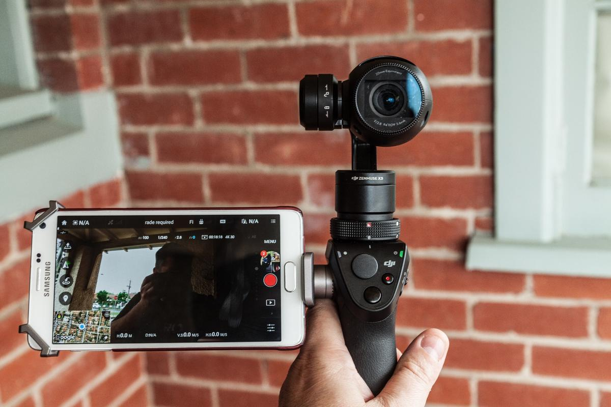"""Clicking the trigger on the front three times swivels the Osmo around into """"selfie mode"""" facing the operator"""