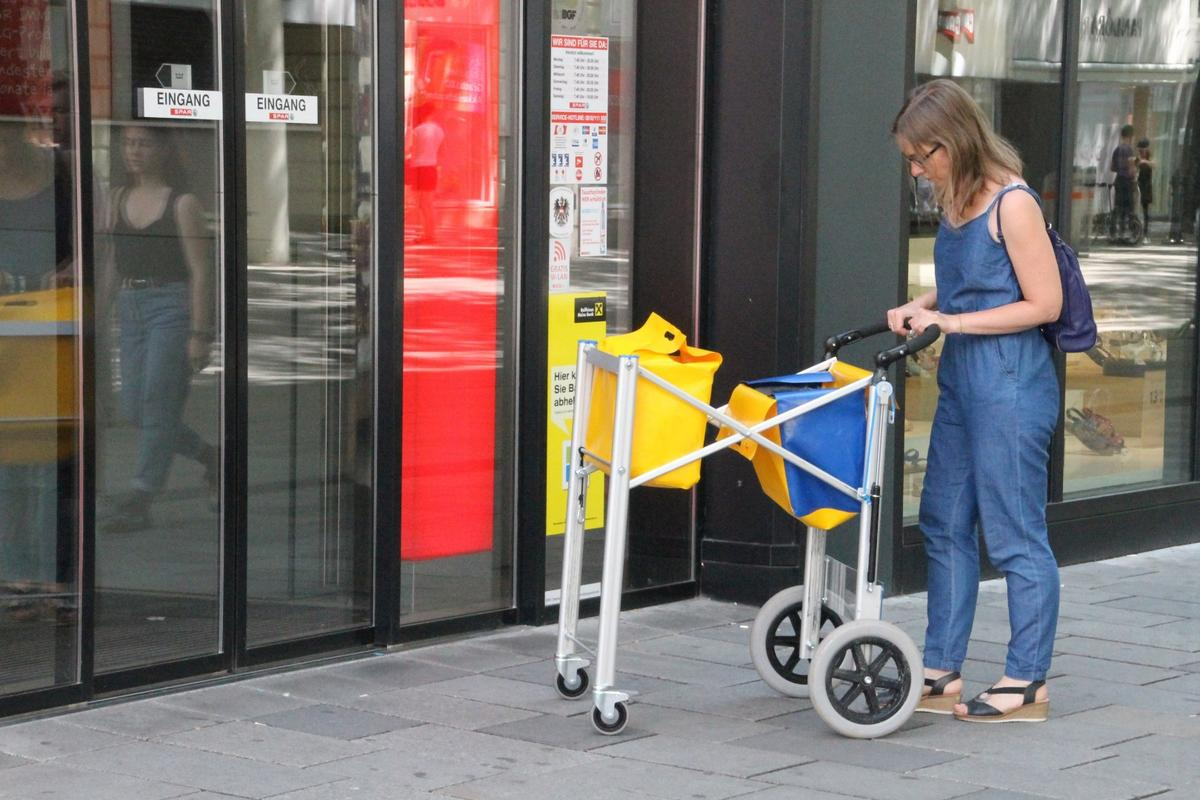 The multifunctional shopping trolley, being used as a grocery cart
