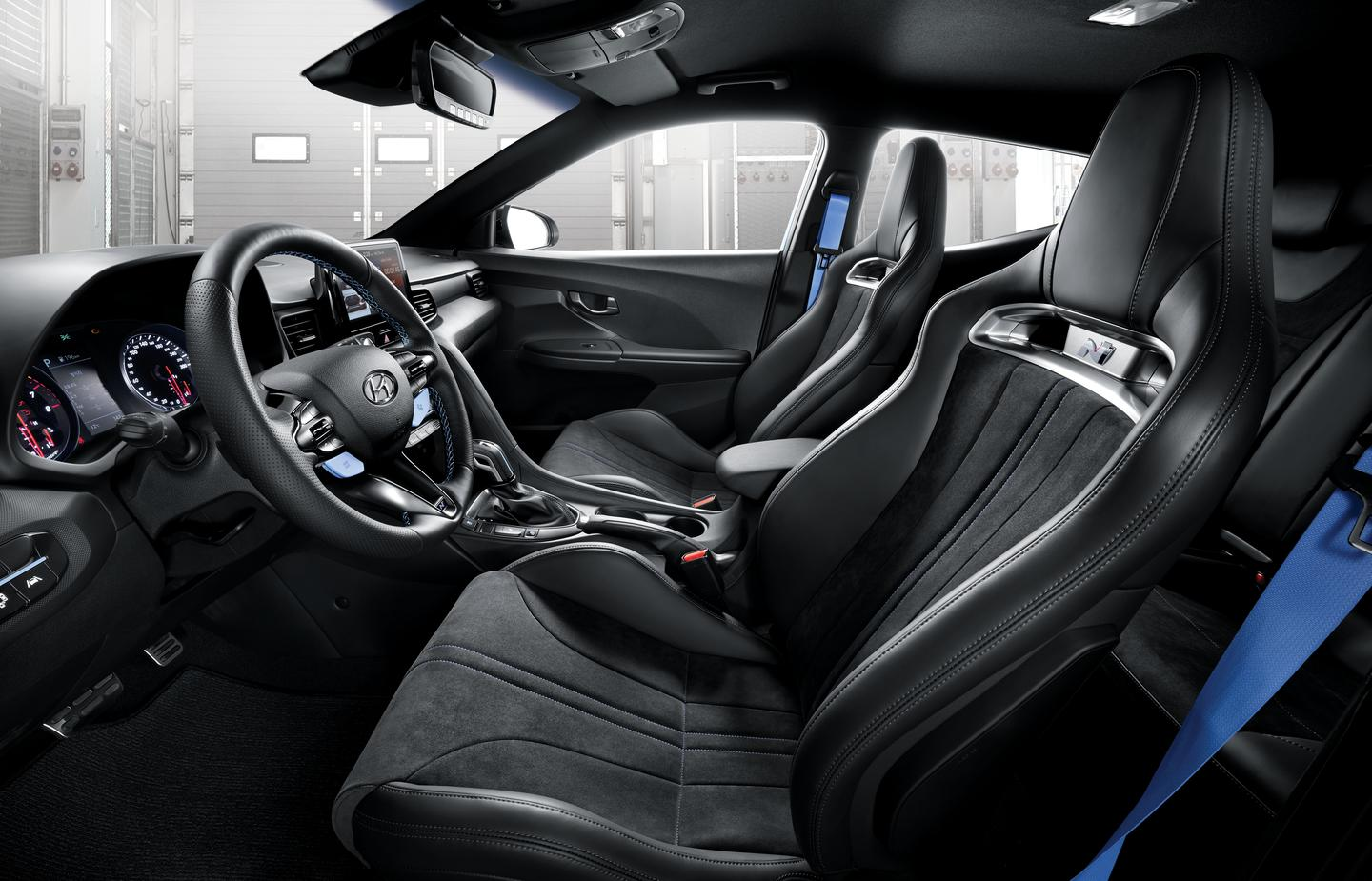 Lightweight bucket seats covered in Alcantara are a neat new option