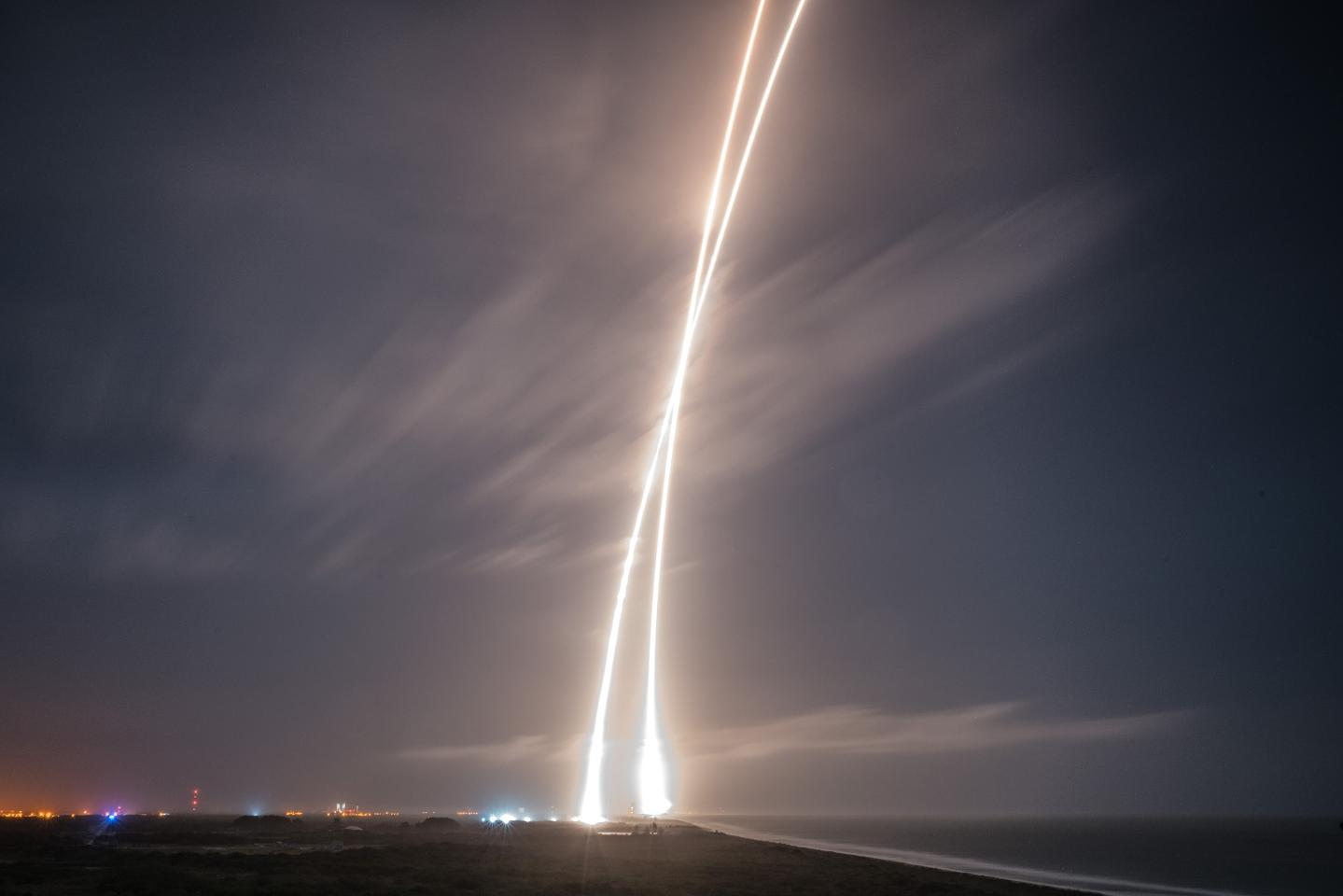 The time-lapsed streaks of a Falcon 9 launch and landing