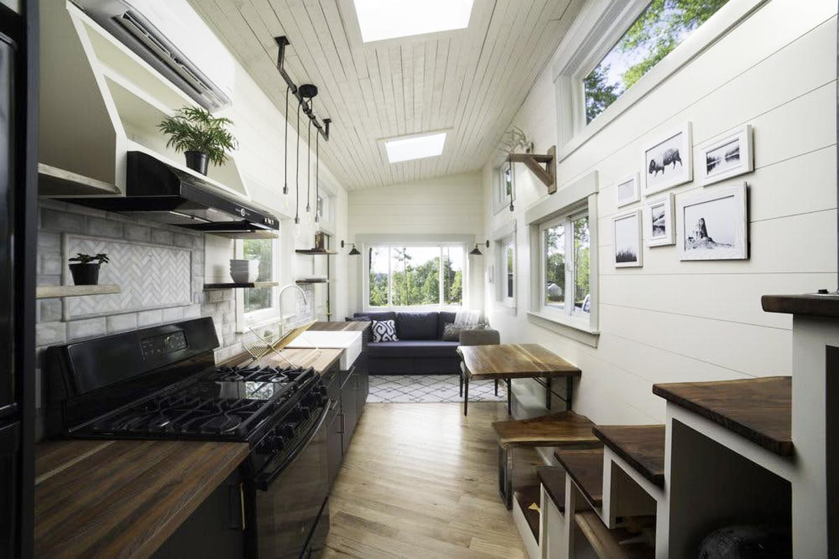 The interior of the Legacy tiny house is a treat of lovers of fine woodworking
