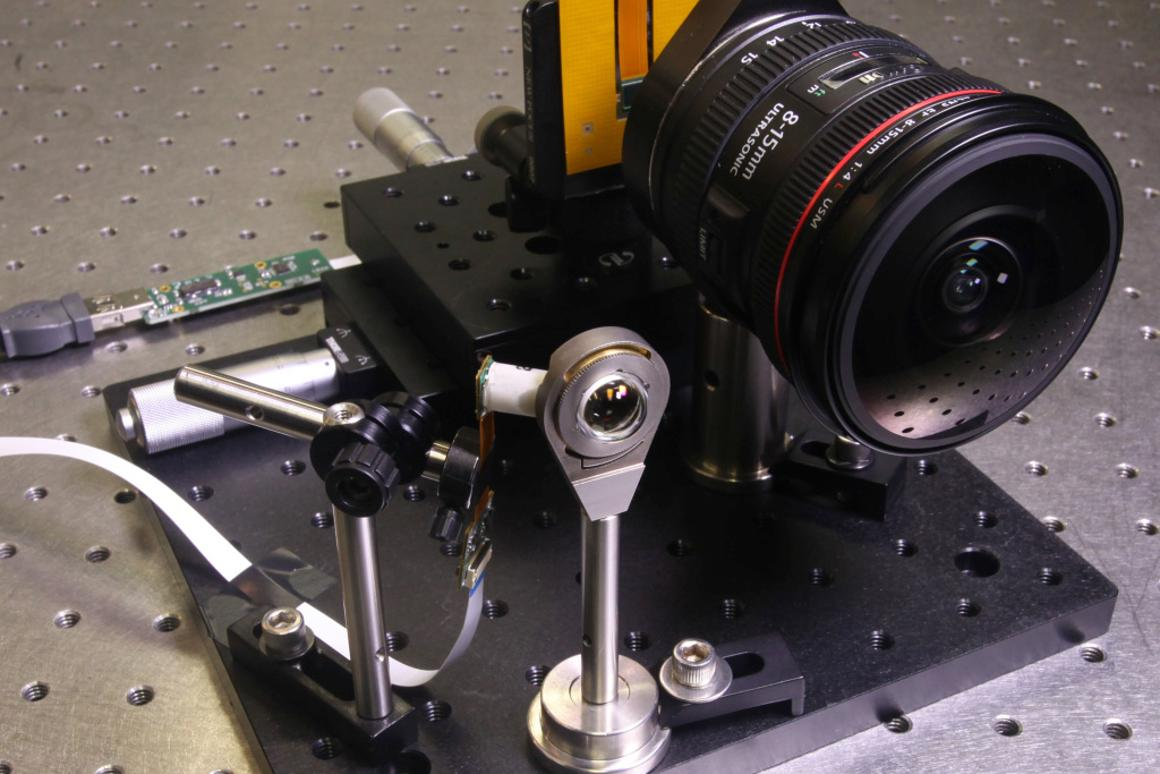 The UC San Diego system (left) as compared to the lens and electronics of a Canon EOS 5D Mark III DSLR