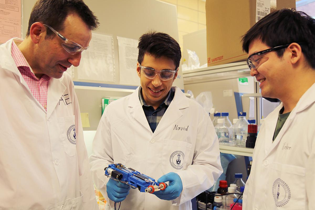 From left to right, associate professor Axel Guenther, Navid Hakimi and Richard Cheng with the skin printer