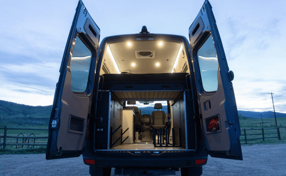 The base package brings the bed, power and lighting, and the Skier/Surfer pack adds the gear racks, water heater and more