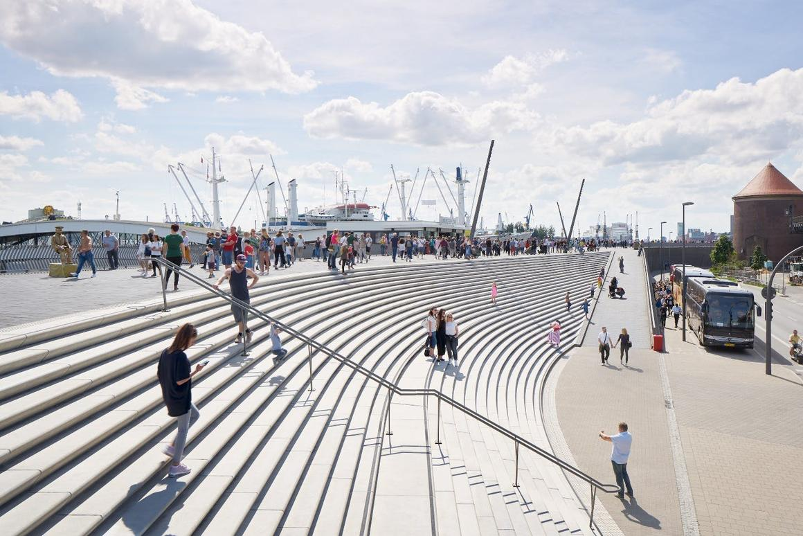 The Niederhafen River Promenade project features large light gray granite amphitheater-like staircases