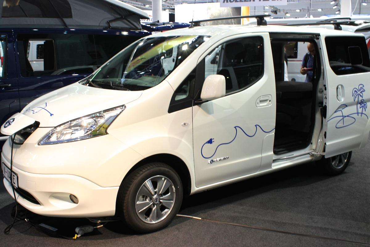 Camper van equipment company Reimo shows the Nissan N-Vane camper van package. Not only is this camper van tiny at 4.6 m (15 ft) long, it's all-electric, based on the e-NV200