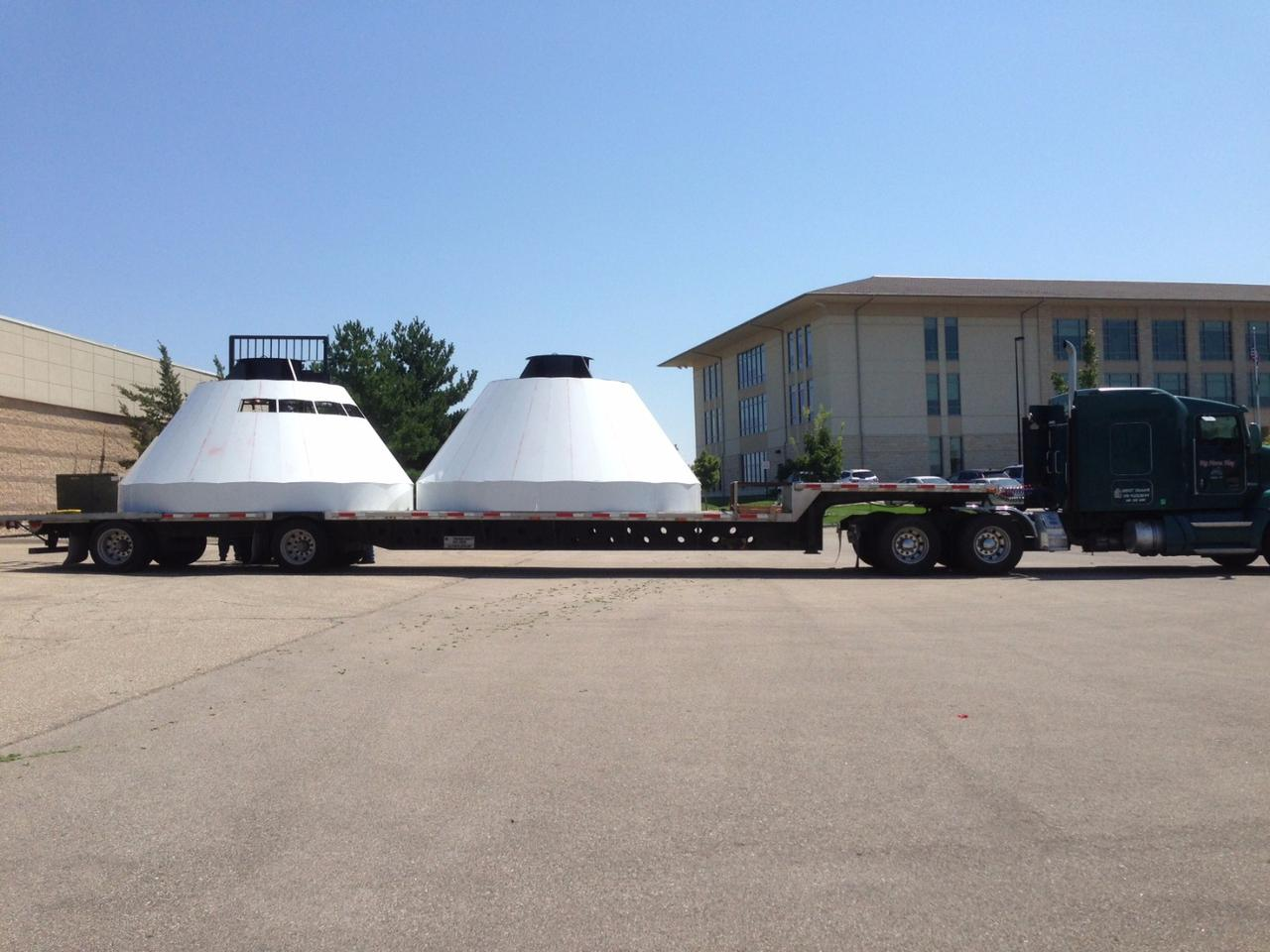 The two halves of a mock Orion spacecraft arrive at Kansas State University