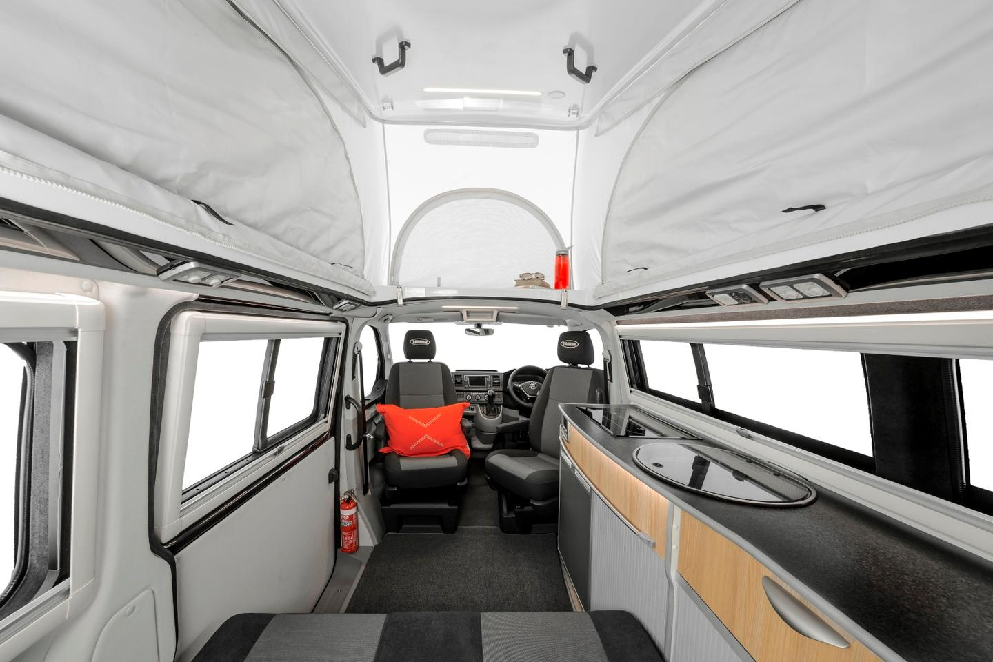 The Trakkadu AT interior includes a sliding rear bench/folding bed, swivel front seats and a kitchen area