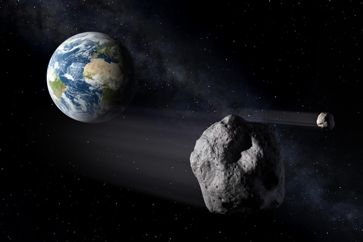 Artist's concept of asteroids passing Earth (Image: ESA/P Carril)