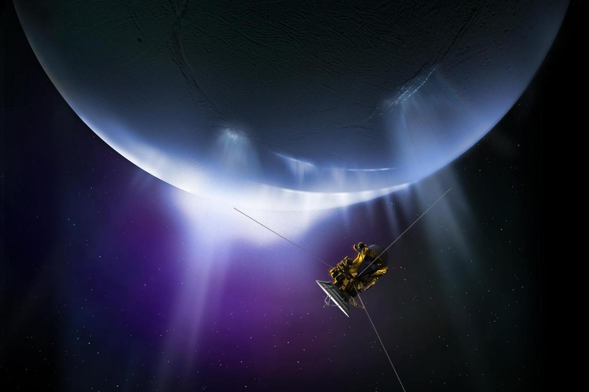 Artists impression of Cassini making its final pass of the icy moon Enceladus