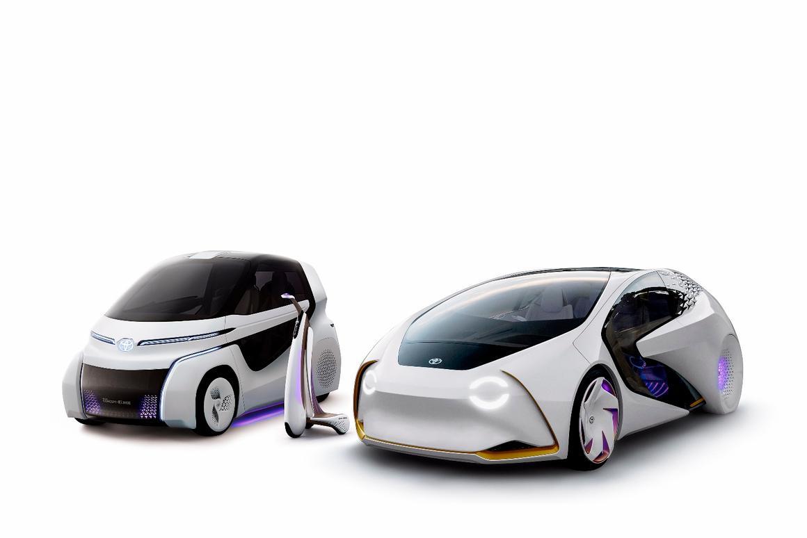 Toyota'sConcept-i Ride alongside its original Concept-i vehicle