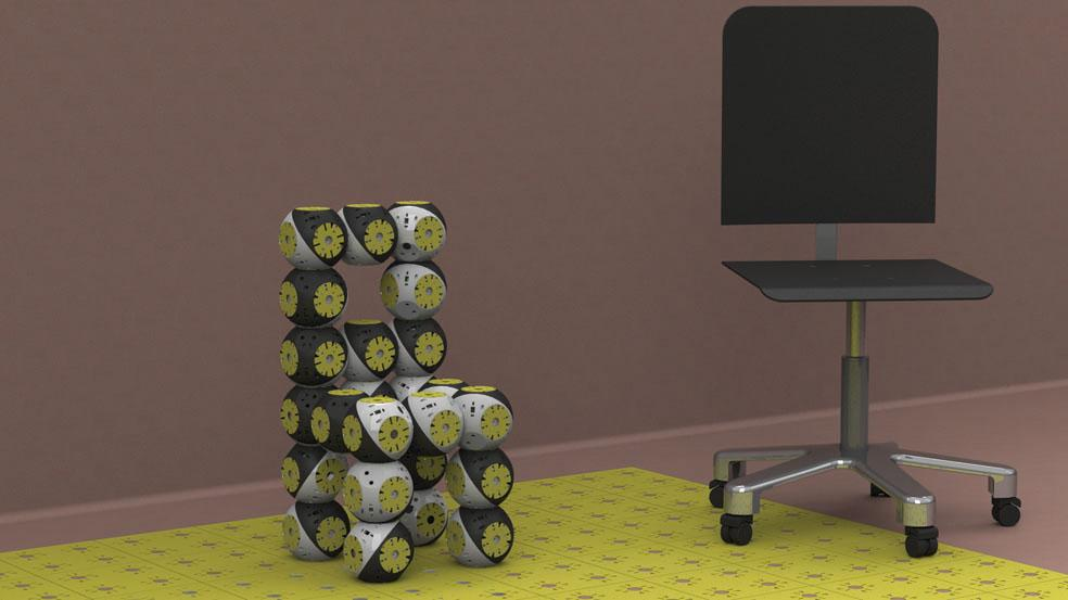 A chair from 12 Roombots modules, and a typical office chair for size comparison (Photo: Biorobotics Laboratory, EPFL)