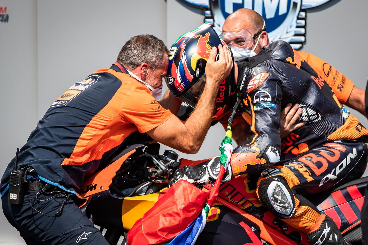 An ecstatic KTM team greets Brad Binder as he returns to parc fermé with the company's first-ever MotoGP win