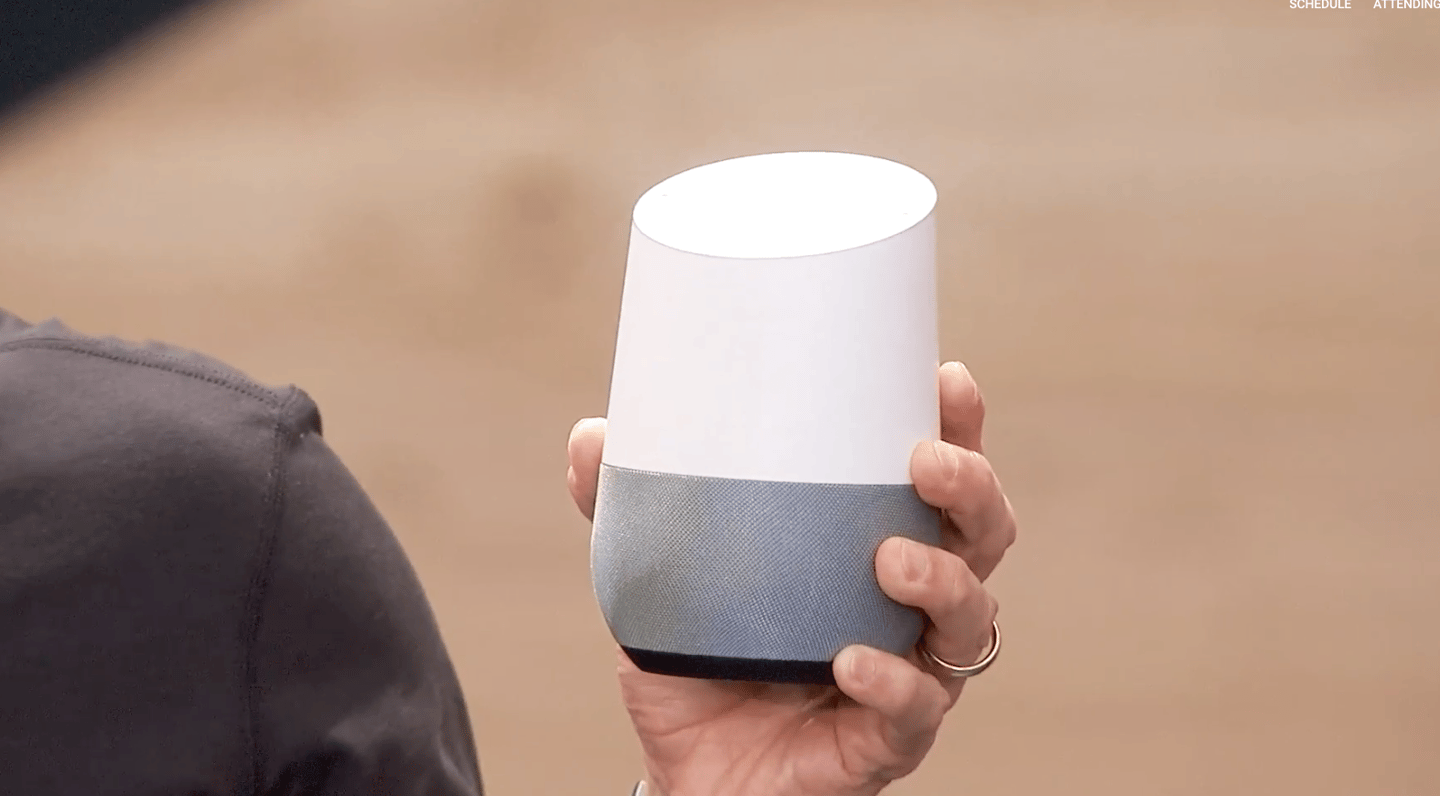 Queiroz holding a Google Home at the 2016 Google I/O conference