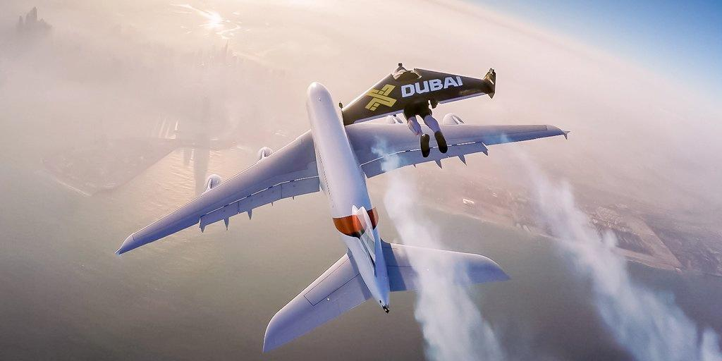 Jetman flies above an Airbus A380 passenger jet in Dubai