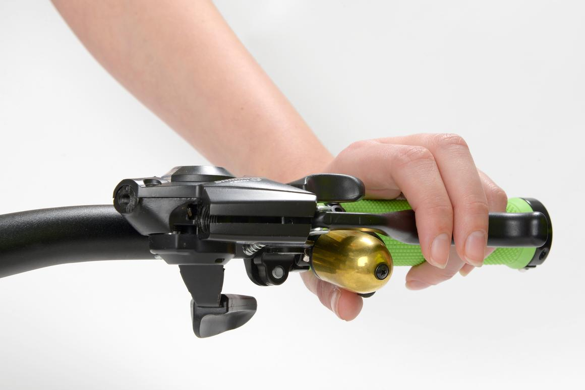 The Trigger Bell allows riders to ring their bell without repositioning their hand