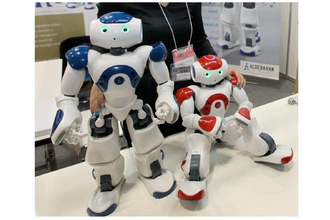 Nao - he sees, can find a ball, recognizes different touches from humans and communicate via Wi-Fi