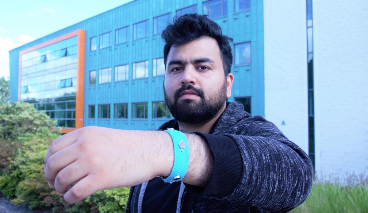 Co-creator Muhammad Umair wearing one of the prototype wristbands