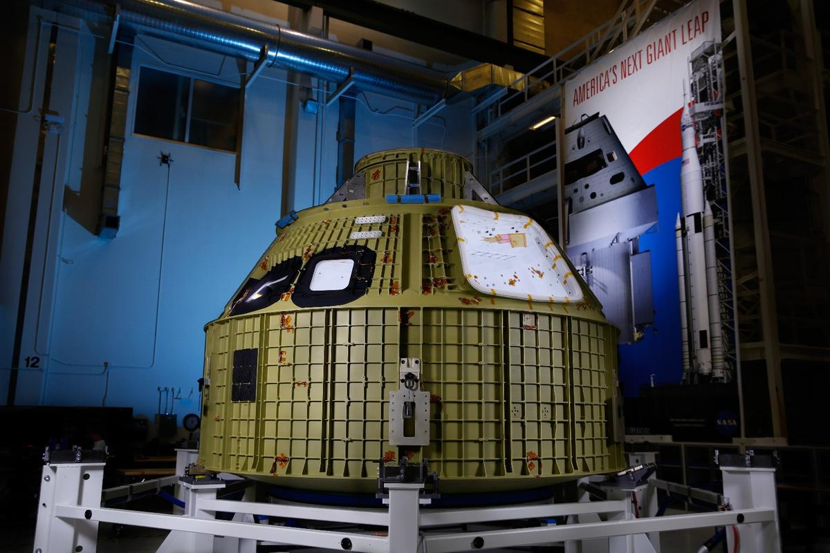 The Orion spacecraft's crew module secured into its structural assembly tool