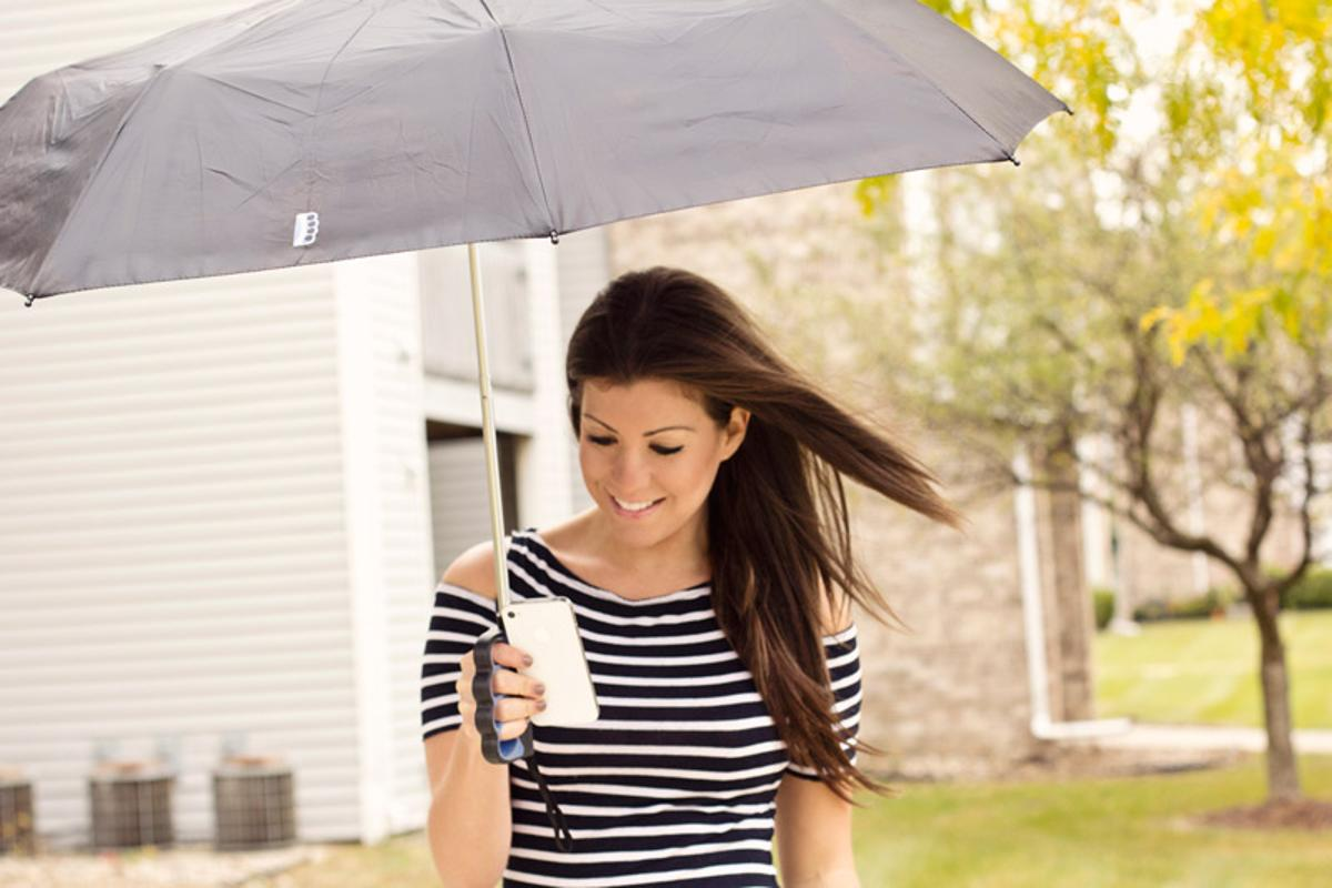 Brolly is an umbrella which sports an innovative finger grip, allowing its user to stay dry and text at the same time