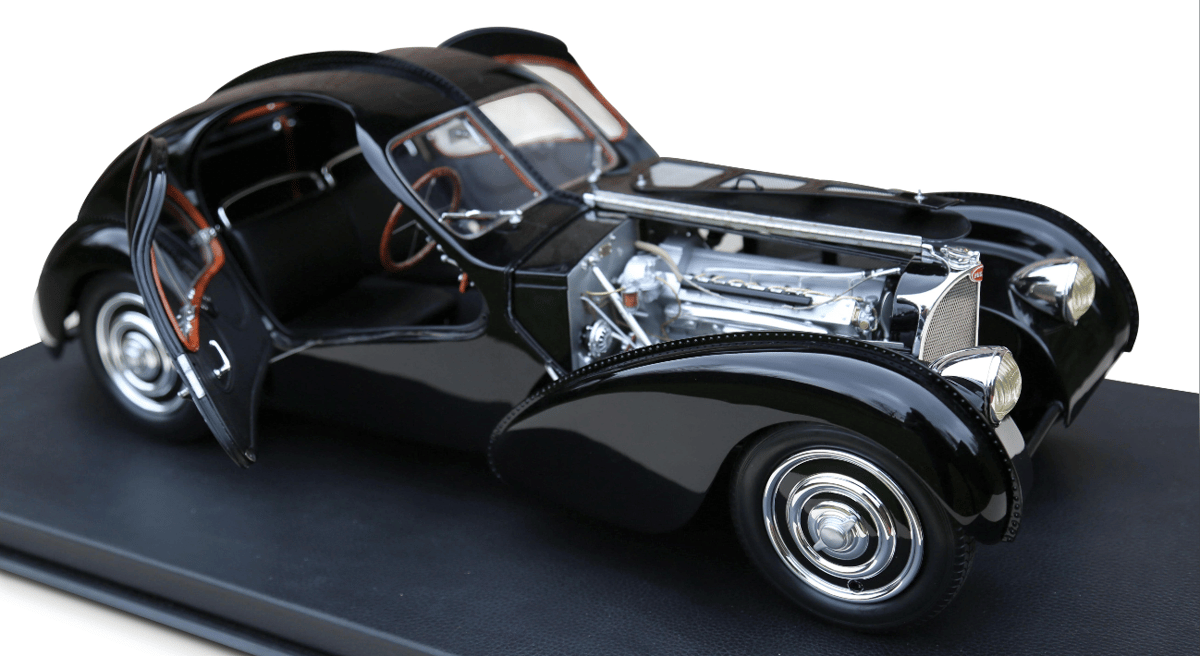 Number 12 of a limited edition of 99 one eighth scale models of a1938 Bugatti 57 SC Atlantic modelcommissioned by Ralph Lauren.Lauren isone of just three people in the world to own a real Bugatti 57 SC Atlantic, which just coincidentally, is a black oneand can be seen here. This model sold for$19,134 (€15,625)