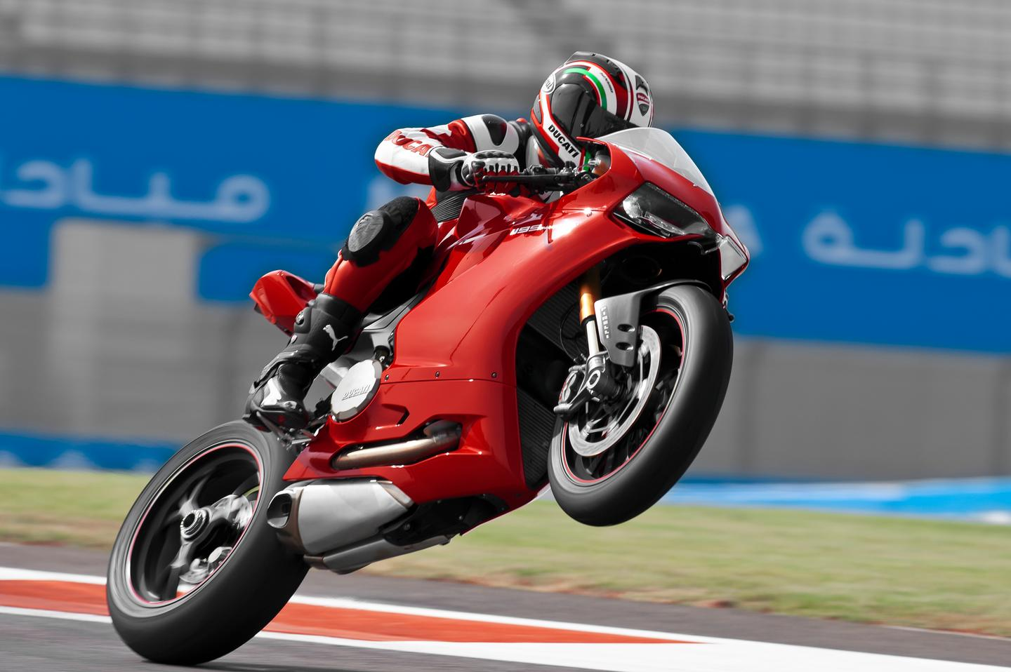 Troy Bayliss on Ducati's newest superbike. A generation of two of big V-twins down the track, and we may be referring to Indian-produced Ducatis.