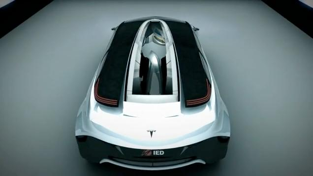 A 3D rendering of the top rear view of the Tesla IED Eye concept car, showing its opening top