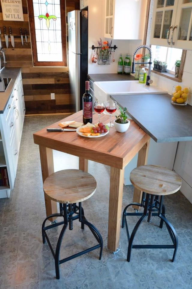 The kitchen inside the Vintage Retreat tiny house includes a movable island bench made from cherry butcher block