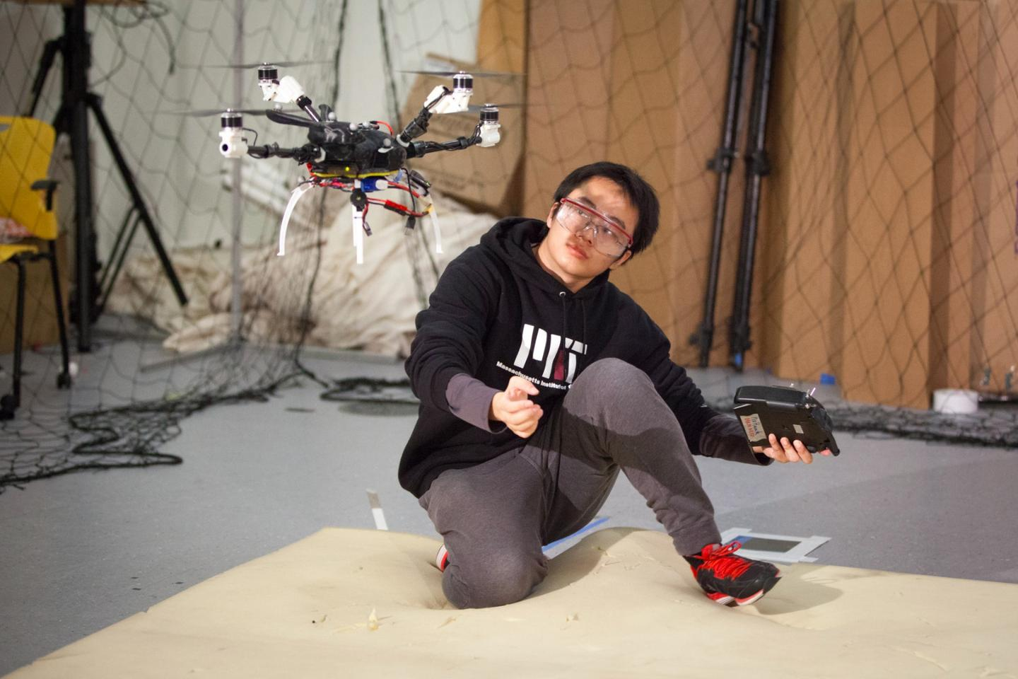 PhD student Tao Du helps one of the team's multicopters take off