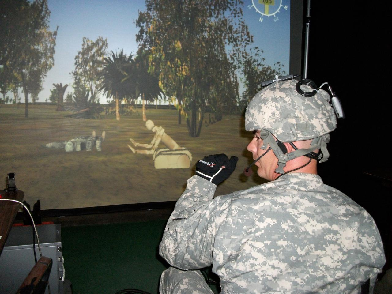 The iGlove enables a warfighter to easily command and control robotic devices through sensors and controllers built into a standard-issue glove (Image: TATRC)