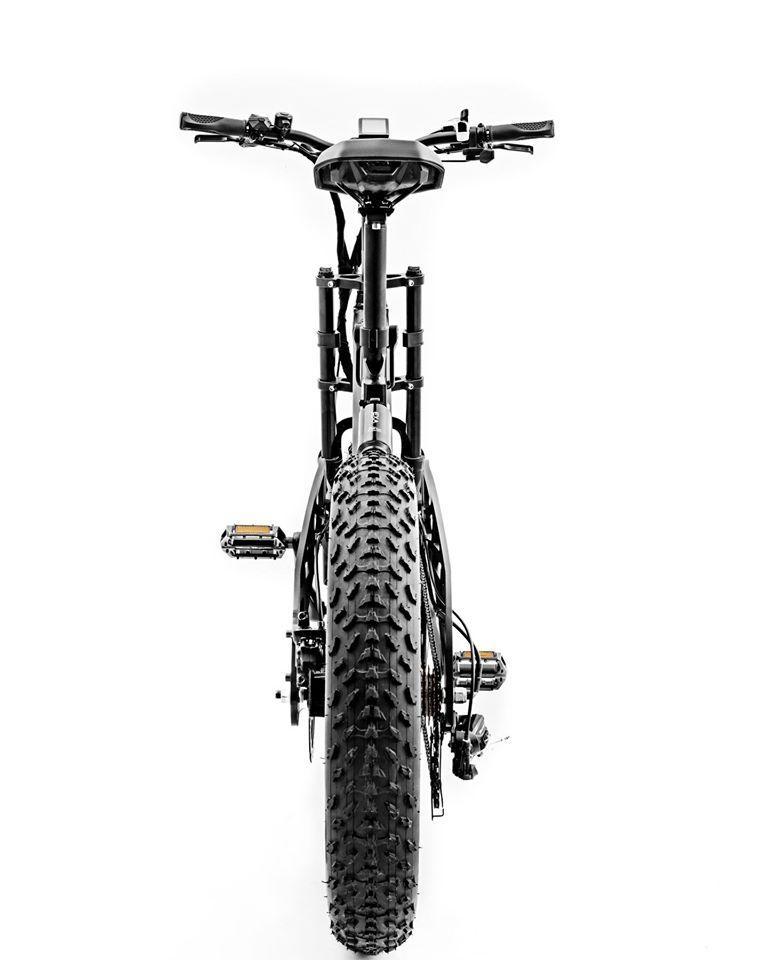 The A1 features a dirt bike handlebar, dirt bike pedals, a Bafang rear hub motor and seven gears